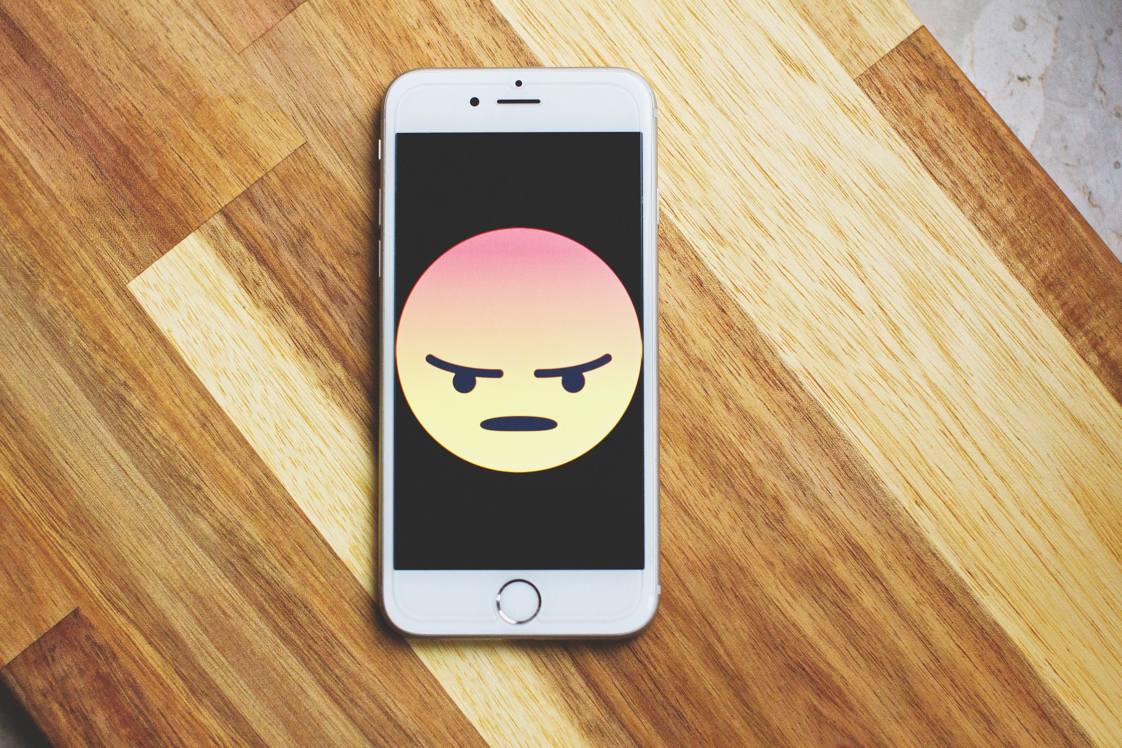 Angry emoji on an iphone screen